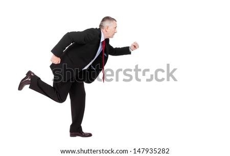 Mature businessman running isolated on white - stock photo