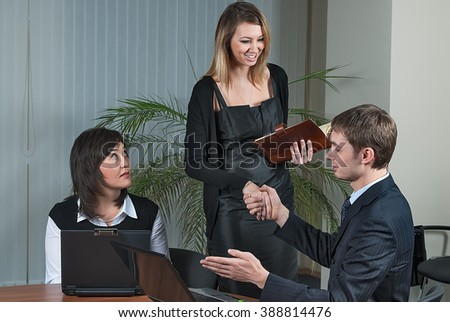 Mature businessman shaking hands to congratulation with young business lady - stock photo