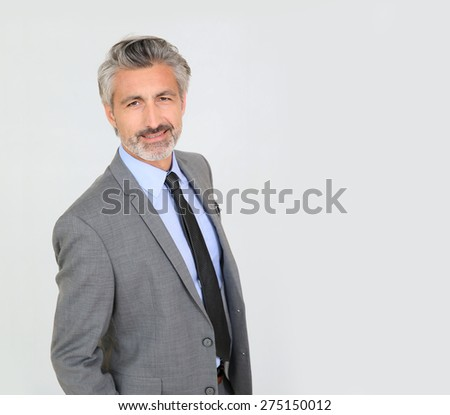 Mature businessman standing on white background, isolated - stock photo