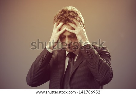 Mature businessman stressed and worried look down - stock photo