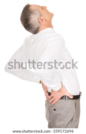 Mature businessman suffering from back pain.