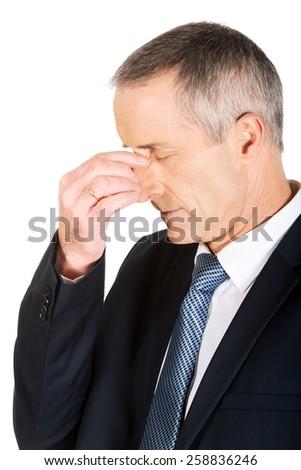 Mature businessman suffering from sinus pain. - stock photo