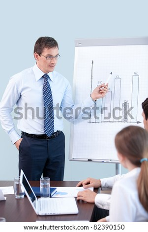 Mature businessman tells a presentation at the office - stock photo