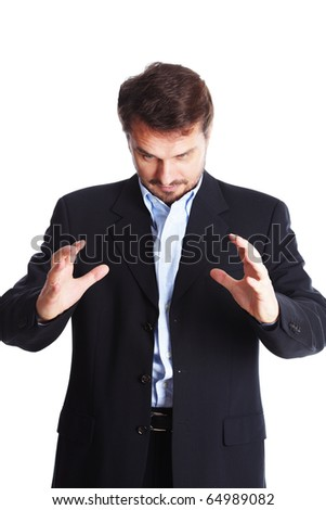 Mature businessman trying to generate energy with his hands - stock photo