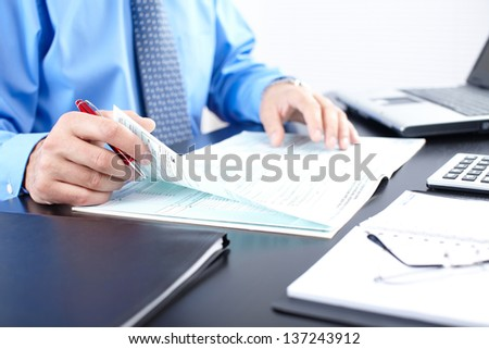 Mature businessman with blue shirt and tie - stock photo