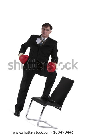 Mature Businessman With Boxing Glove Isolated Over White Background