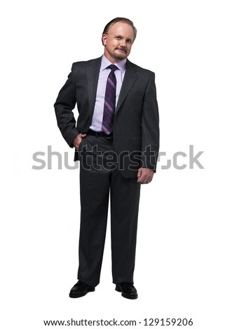Mature businessman with hands in pocket over white background