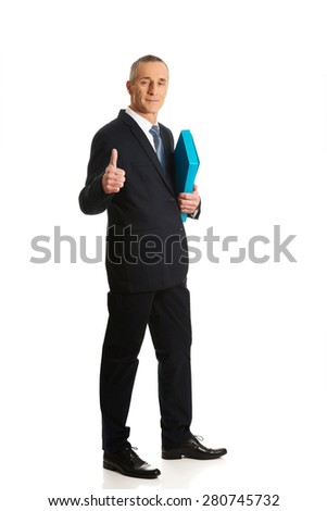 Mature businessman with ok sign. - stock photo