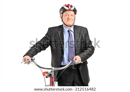 Mature businessperson holding a bicycle, isolated on white background - stock photo