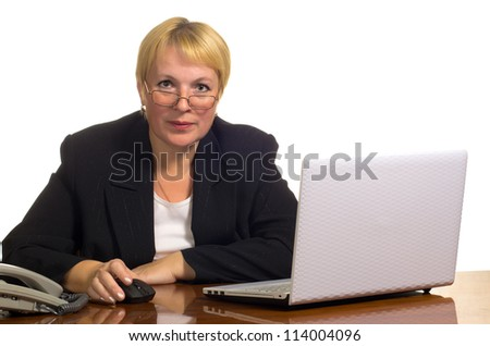Mature businesswoman looking at you over glasses. Isolated against white background.