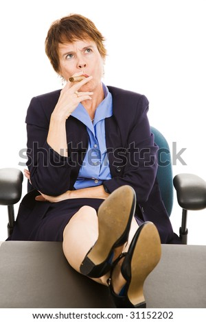 Mature businesswoman smoking a cigar and thinking with feet on her desk.  Isolated on white. - stock photo