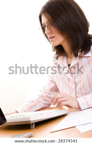mature businesswoman working at her office - stock photo