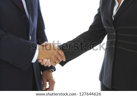 Mature Caucasian business male and female shaking hands isolated on white background.