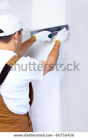 Mature contractor plasterer working indoors