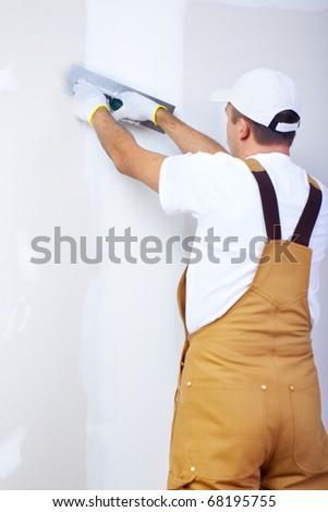 Mature contractor  plasterer working indoors - stock photo