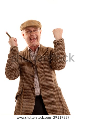Mature country gent in tweeds after his horse won the race - stock photo