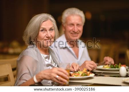 Mature couple at restaurant - stock photo