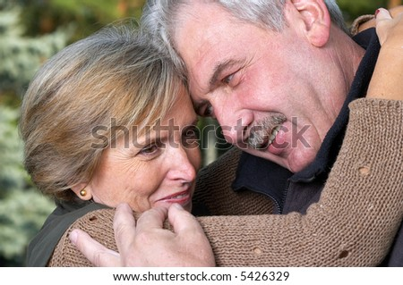 Mature couple embracing each other. - stock photo