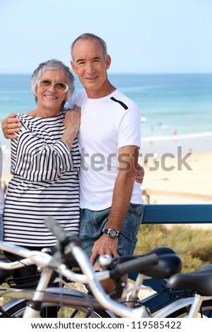 Mature couple embracing on promenade - stock photo