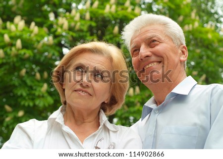 Mature couple enjoy union with nature, fresh air and stunning views - stock photo