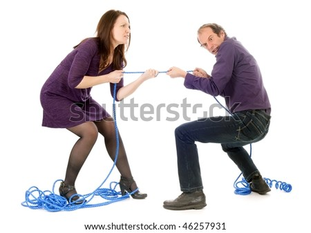mature couple fighting together pulling rope isolated on white - stock photo