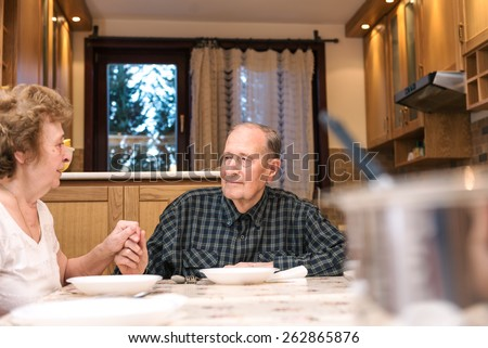 Mature couple having great time, romantic emotional moments. Blurred foreground, shallow depth of field. - stock photo