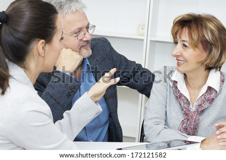 Mature couple having meeting with financial advisor. - stock photo