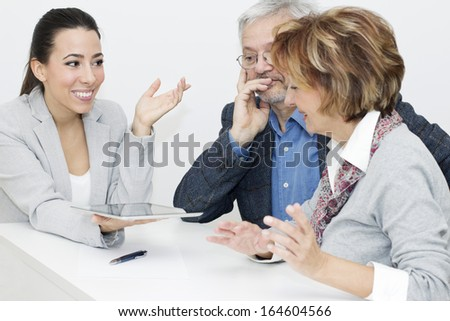 Mature Couple in Meeting With Advisor. - stock photo