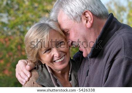 Mature couple laughing a lot. - stock photo