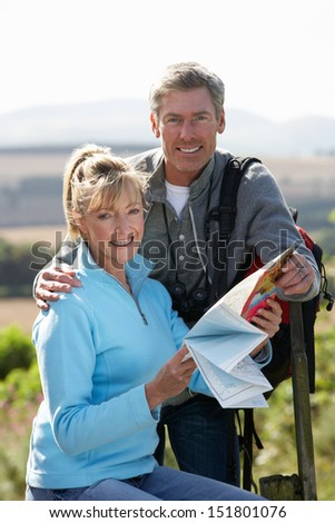 Mature Couple On Country Walk - stock photo