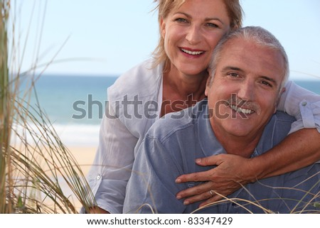 mature couple shining with happiness - stock photo