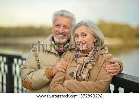 Mature couple walking - stock photo