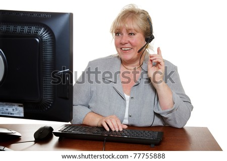 "Mature customer service representative with headset ""just one second"" - stock photo"