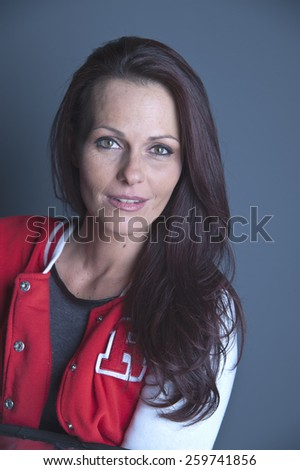 Mature dark haired woman smiling - stock photo