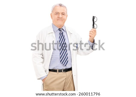 Mature doctor holding a pair of glasses isolated on white background - stock photo