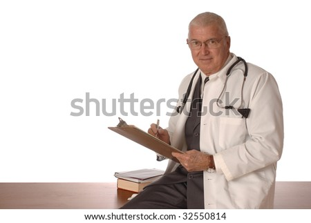 Mature doctor sitting on a desk with a white background - stock photo