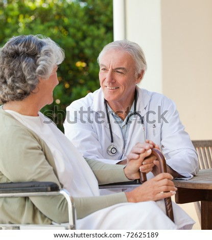 Mature doctor with his senior patient - stock photo