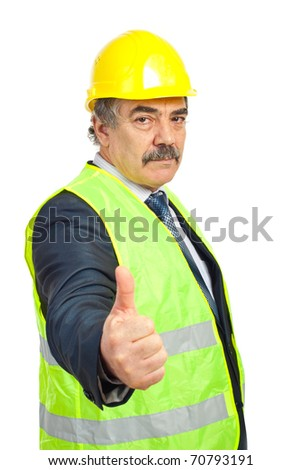 Mature engineer with helmet and vest giving thumb up isolated on white background