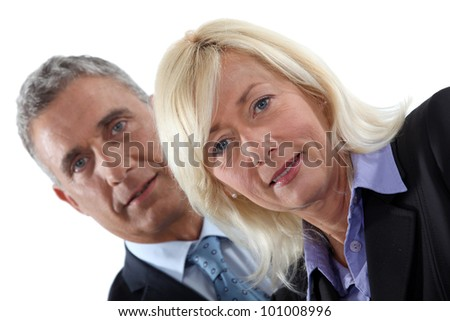 Mature executive couple - stock photo
