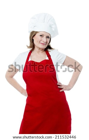 Mature female chef posing with hands on her waist