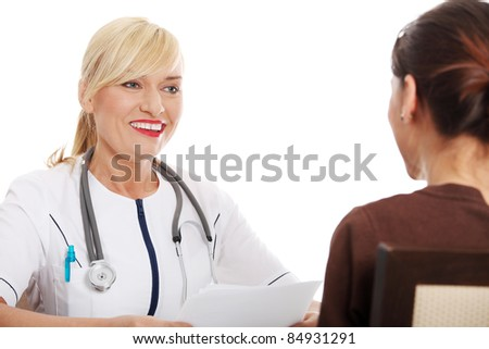 Mature female doctor talking with her patient. - stock photo