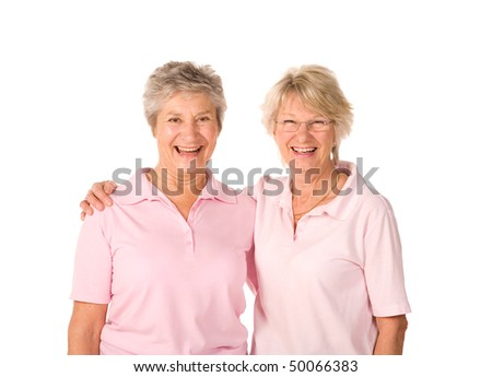Mature female friends relaxing after workout at the gym - stock photo