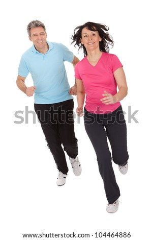 Mature fitness couple running towards camera. Isolated on white - stock photo