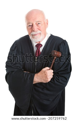 Mature friendly judge with gavel.  Isolated on white.   - stock photo