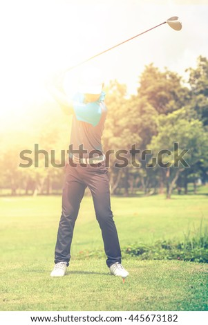 Mature Golfer on a Golf Course Taking a Swing on the Start
