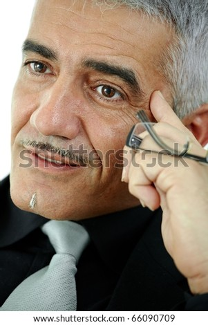 Mature gray haired creative looking businessman thinking, isolated on white background.? - stock photo