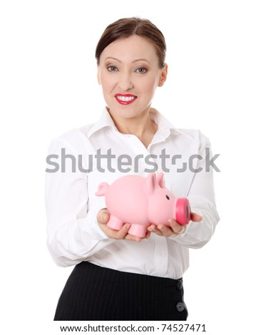 Mature happy businmesswoman standing with piggy bank (money box), isolated on white background - stock photo