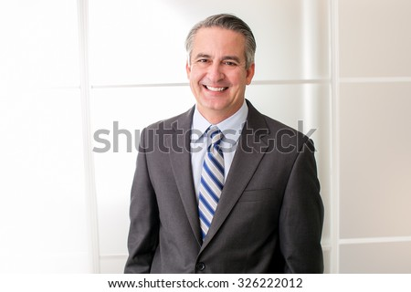 Mature happy smiling business man in an office - stock photo