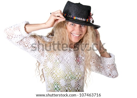 mature hippie woman with las vegas hat smiling - stock photo