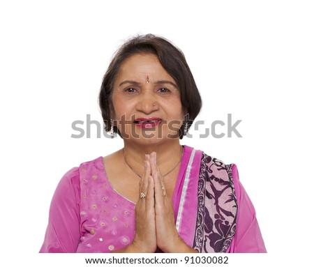 Mature indian woman doing namaste greeting with joined hands